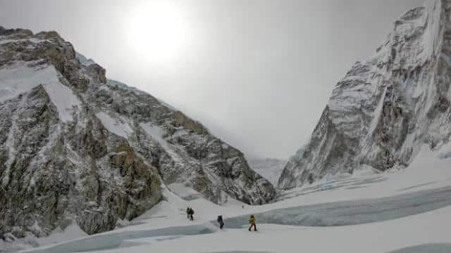 mountaineers ascend on their way to the summit of Everest