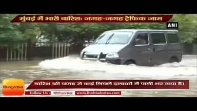 Heavy rains lash Mumbai Local train services delayed traffic hit due to waterlogging