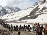 Pilgrims on way to Amarnath Yatra on their mules against backdrop of the Himalayas. (HT File Photo)