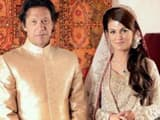 Pakistan's cricketer-turned-politician Imran Khan and TV anchor Reham Khan pose for photographs afte