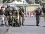 Afghan security personnel arrive after a large explosion near the Kabul Airoprt on Sunday. (AP)