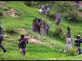 Army personnel take positions during an encounter with the militants in north Kashmir in June 2018.