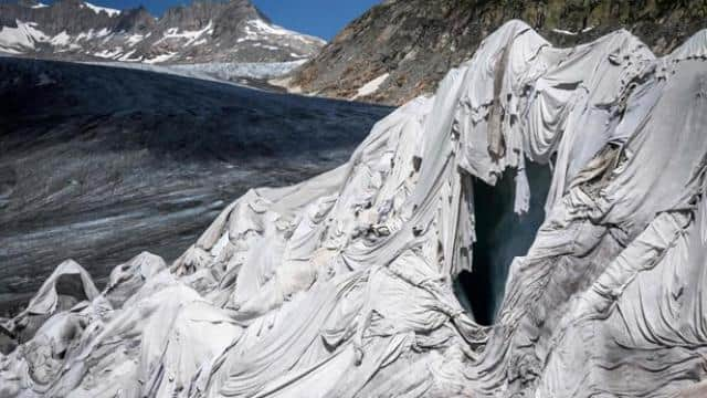 Glacier covered with insulating foam to prevent it from melting