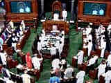 Members stand for the national anthem in the Lok Sabha on the last day of the Monsoon session of Par