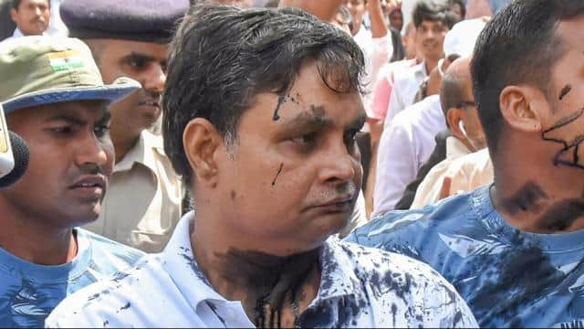 Brajesh Thakur, main accused in the Muzaffarpur shelter home case , after a woman allegedly threw in