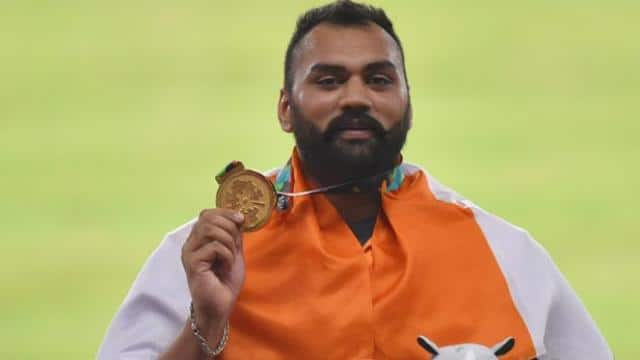 Tajinderpal Singh Toor breaks record and wins gold for india