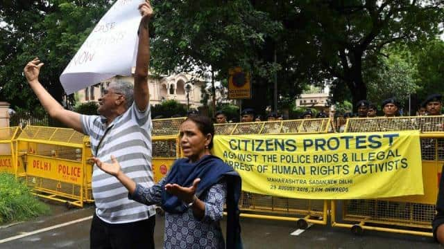 Dalit rights activists and intellectuals shout slogans against the police raid(AFP)