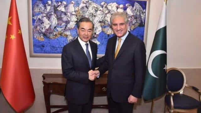 Pakistan's foreign minister Shah Mehmood Qureshi shakes hand with state councillor and foreign minis