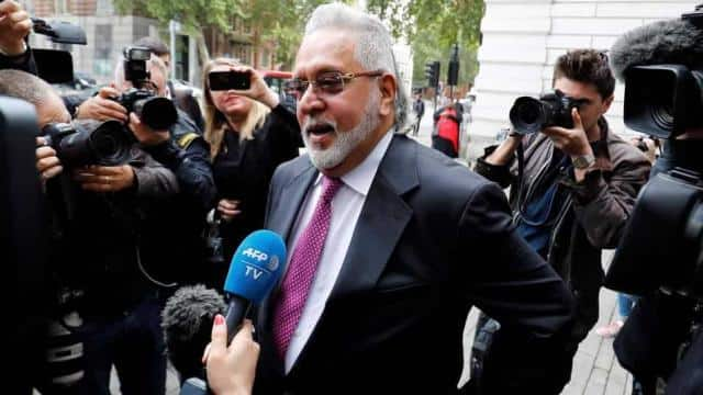 Vijay Mallya speaks to members of the media as he arrives to appear at Westminster Magistrates Court