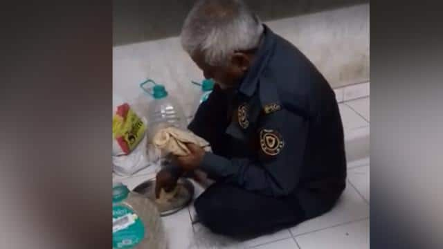 security guard eating roti with water