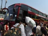 Wokers from Uttar Pradesh state board a buses as they leave in Ahmedabad (AFP File Photo)