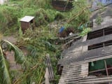 Damaged houses at a village along the Odisha-Andhra Pradesh border after cyclone Titli passed throug