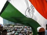 File photo of a Congress supporter holding a huge flag an election campaign rally in Mumbai.(Reuters