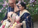 Rajkumar Sharma with his wife and Virat and Anushka