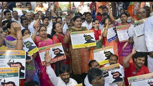 JP Party leaders and workers raise slogans against the State Government as they oppose the celebrati