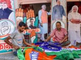Workers prepare promotional materials for BJP and Congress ahead of the Rajasthan Assembly Elections