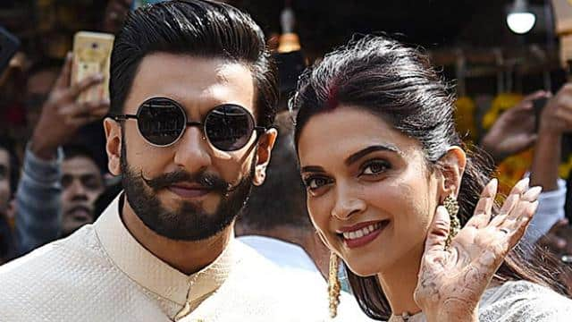 Newly-wed Bollywood actors Deepika and Ranveer pose for photos on their visit to Siddhivinayak
