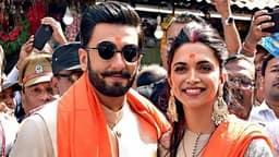 Newly-wed Bollywood actors Deepika and Ranveer pose for photos on their visit to Siddhivinayak Templ