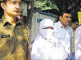 Sunil Kumar (face covered), accused of raping and murdering at least 15 minor girls in Gurugram, Gwa