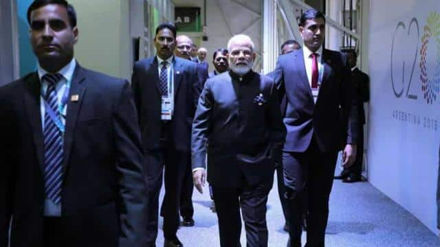 India's Prime Minister Narendra Modi (C) arrives for a bilateral meeting on the second day of the G2