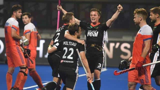 Germany's Mats Grambusch (C) with teammates celebrate a goal against Netherland during the field hoc