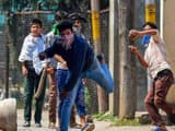 Students throw stones at the police during a protest over arrest of the student Adil when he was ent