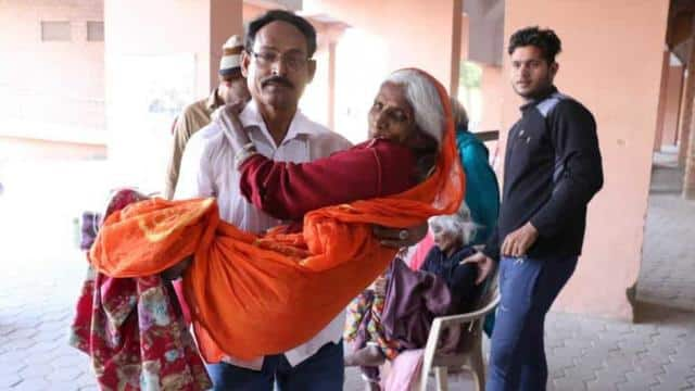 Dakha Devi's 90-year-old daughter, Birmi Devi, being carried inside polling booth. (HT Photo)