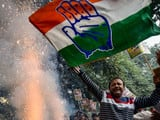 Congress workers and supporters burst fire crackers to celebrate the party win