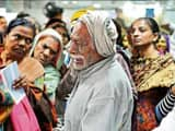 This HT photo by Praveen Kumar of an old man crying after missing his spot at the State Bank of Indi