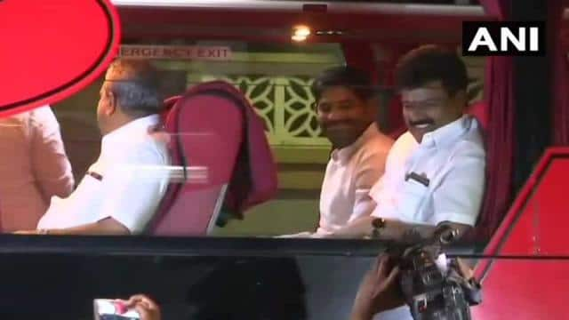Congress MLAs are seen seated in a luxury bus in Bengaluru on their way to a Eagleton resort on the