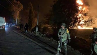 20 dead, 60 burned in fire at tap on Mexico fuel pipeline