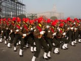 Indian soldiers takes part in the rehearsal for the Republic Day parade on a foggy winter morning