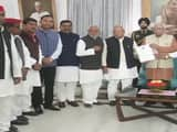 A 15-member joint delegation of SP-BSP submits a memorandum to Governor Ram Naik over the matter of