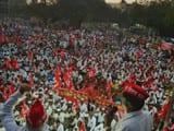 Farmers gather at Mumbai Naka Mahamarg bus stop, Nashik to take part in the All India Kisan Sabha's