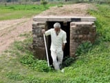 A border villager comes out from a community bunker at Chandu Chak village of Ranbir Singh Pura sect