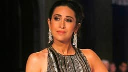 Bollywood actress Karishma Kapoor walks the ramp during a fashion show