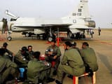 Pakistan Air Force personnel sit in front of their JF 17 jet fighter in Guangdong province, China.(A