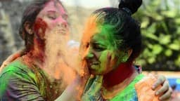 playing holi colors photo