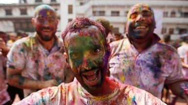 people celebrating holi across the country