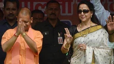 mathura  uttar pradesh chief minister yogi adityanath during an election campaign with mp hema malin