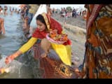 statue immersion of mother parvati and lord shivas in ganga river at bhagalpur during devotion songs