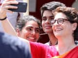 priyanka gandhi vadra clicks a photograph of her children outside the collector office