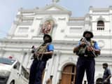 sri lankan military officials stand guard in front of the st  anthony s shrine  kochchikade church a