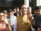 union home minister and bjp candidate rajnath singh was among the early voters in gomtinagar polling