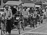 rickshaw puller  symbolic image