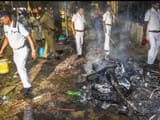 police personnel douse burning vehicles caused by a mob during bjp president amit shah s election ro