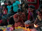 sri lanka civil war women mourn at the graves of their relatives who died in 2009   ap may 18  2015