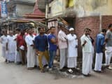voters queue up outside a polling booth in metibruz area in west bengal   s diamond harbour constituen