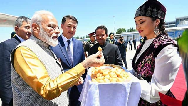 pm narendra modi being welcomed by the dignitaries on his arrival in bishkek kyrgyzstan