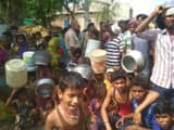 people on road in munger due to scarcity of water in fierce heat